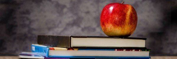 An apple and a stack of textbooks