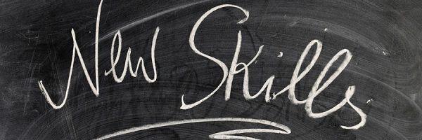 "A chalkboard with ""New Skills"" written on it."