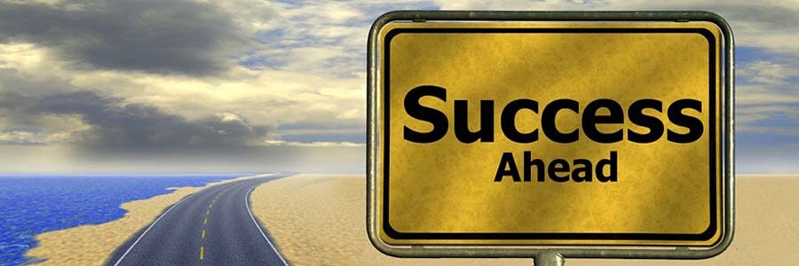 Success ahead sign along a highway