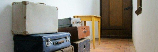 Suitcases in an empty hallway.