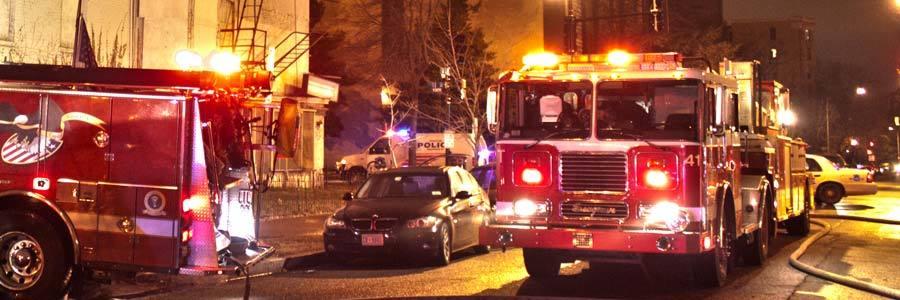 Emergency vehicles on a city street.