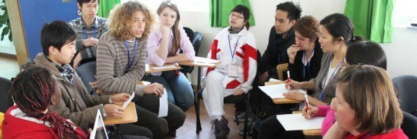Students talking in a classroom