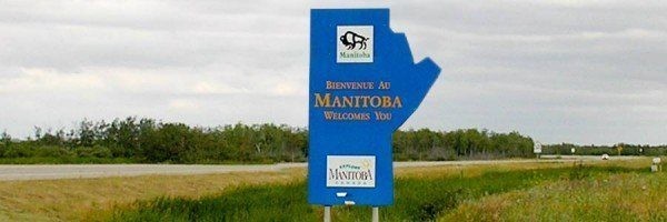 Welcome to Manitoba sign at the Manitoba/Saskatchewan border on the Trans-Canada 16