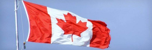 Canadian flag billowing in the wind