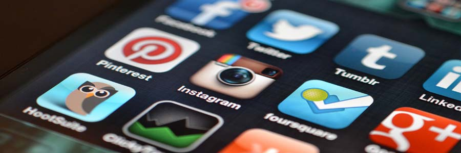 Social media app icons on a mobile device screen