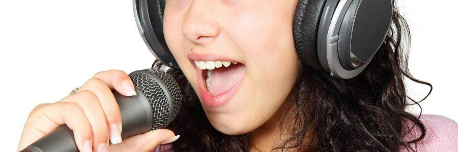 girl with headset singing on a microphone