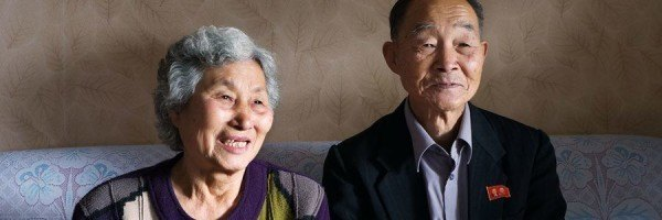 Smiling elderly Korean couple.