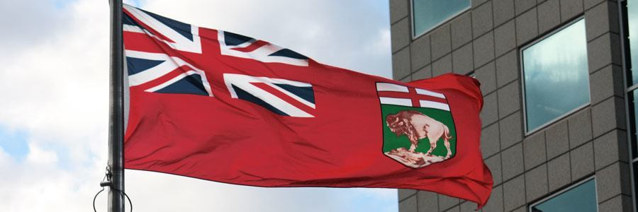 The flag of the Canadian province of Manitoba, flying in downtown Winnipeg