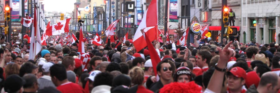 Crowd celebrating on Granville Street and Robson Street in downtown Vancouver following the Men's Hockey Final between Canada and the United States during the 2010 Vancouver Winter Olympic Games.