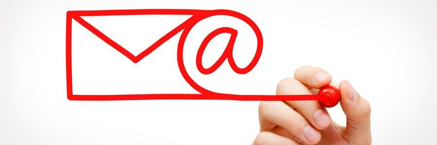 Hand writing an email symbol