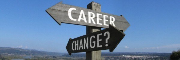 """Crossroads sign, with words """"Career Change?"""" painted on it."""