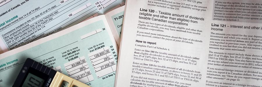 Canadian income tax booklet and papers.