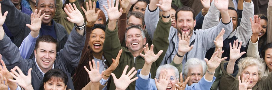 Group of happy multiethnic people raising hands together