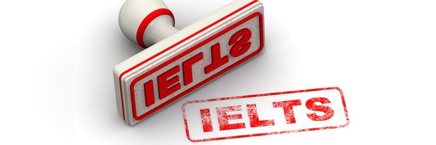 """Red seal and imprint """"IELTS"""" on white surface"""