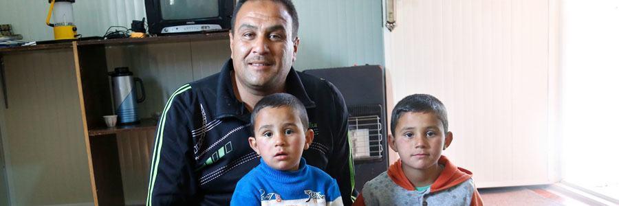 Mahmoud Abu Ibrahim, a Syrian refugee in Jordan, with his sons Ibrahim and Ala.