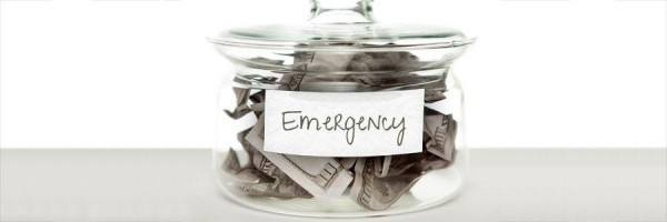 "Money jar with ""Emergency"" written on it"