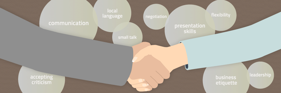 Illustration of a handshake with soft skills listed in bubbles: communication, local language, small talk, negotiation, presentation skills, flexibility, accepting criticism, business etiquette, and leadership.