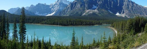A turquoise lake with mountains behind, in Banff National Park, Alberta, Canada.