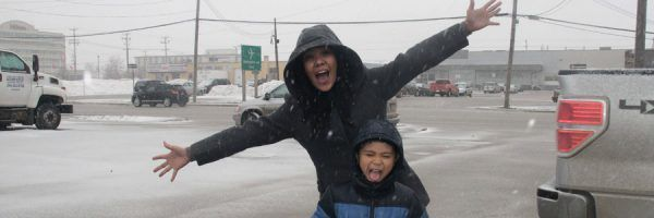 The author and her nephew tasting falling snow in Winnipeg.