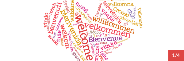 "The word ""Welcome"" in many languages, forming a heart shape."