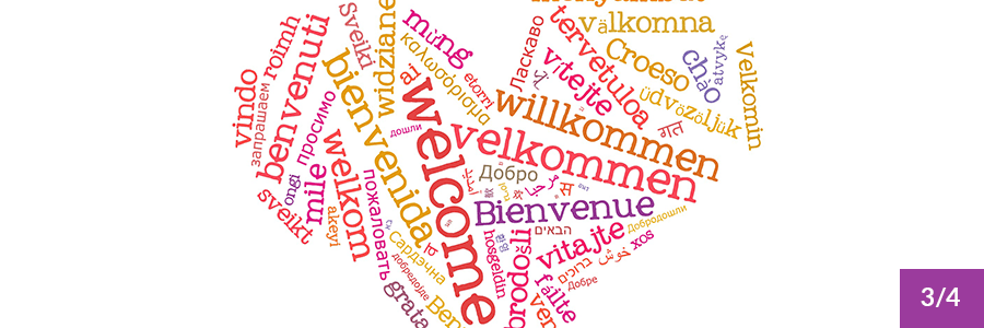 """The word """"Welcome"""" in many languages, forming a heart shape."""