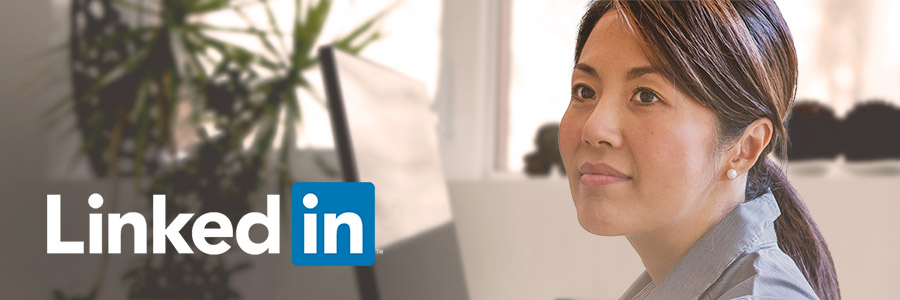 LinkedIn logo overlaid on an image of a woman in a modern office.