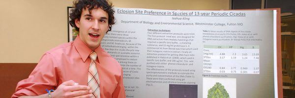 Young man presenting a research project.