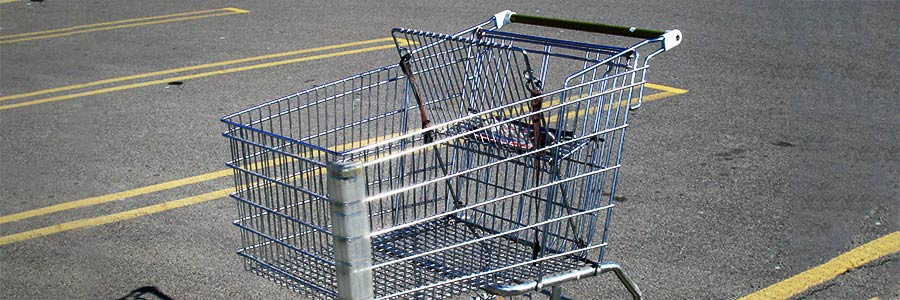 Photo of a shopping cart in a parking lot.
