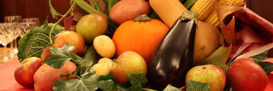 A pile of harvested fruits and vegetables from the late summer or fall.