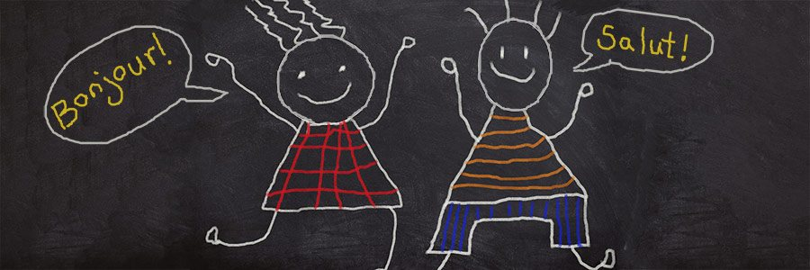 "A drawing on a chalkboard of two kids saying ""Bonjour"" and ""Salut""."