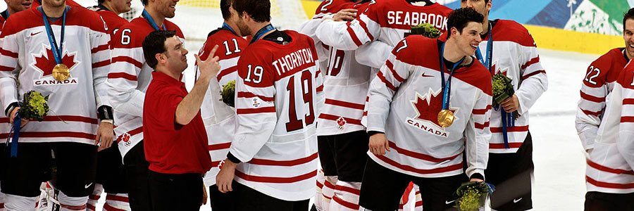 Canada forward Sidney Crosby celebrates with the gold medal after defeating the United States during the 2010 Winter Olympics.