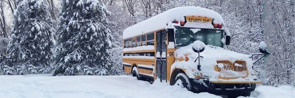 A school bus covered in snow.