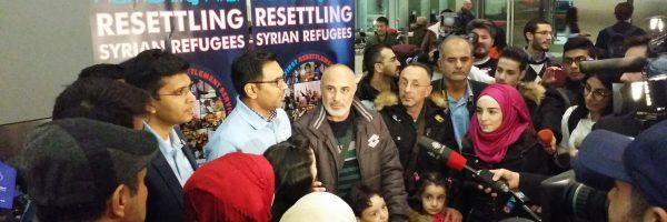 Refugee family in a press conference