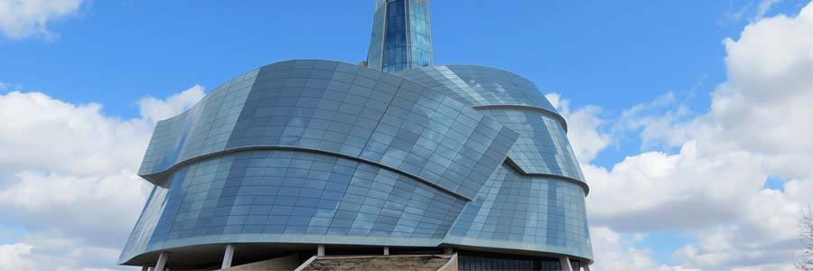 The CMHR building amid the backdrop of clear, blue skies