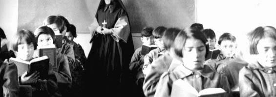 children reading in a classroom at a residential school