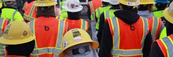 A group of workers wearing safety gear