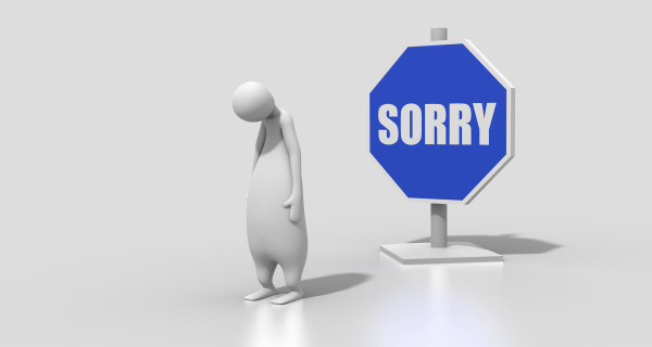 """creature with head hung low with """"sorry"""" sign"""