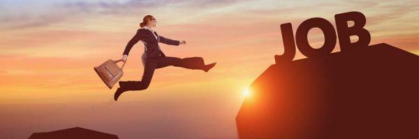 businesswoman jumping to a higher level