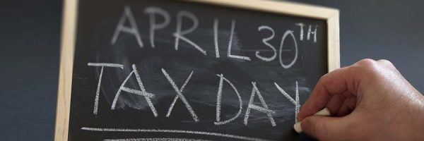 """Chalkboard with the words """"April 30th Tax Day"""""""
