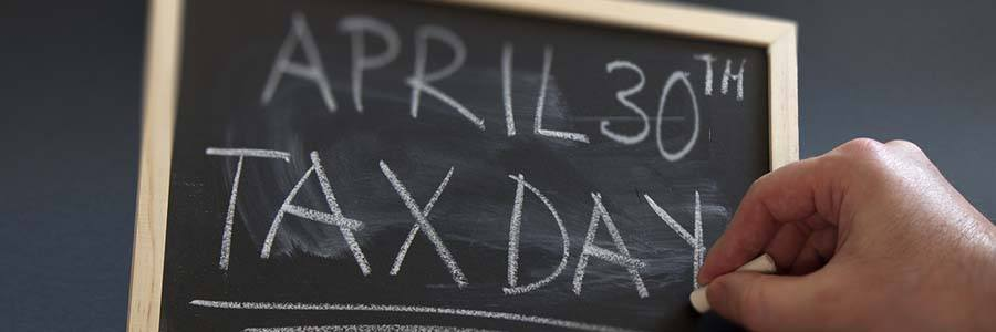 "Chalkboard with the words ""April 30th Tax Day"""