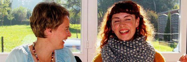 Two women chatting and laughing