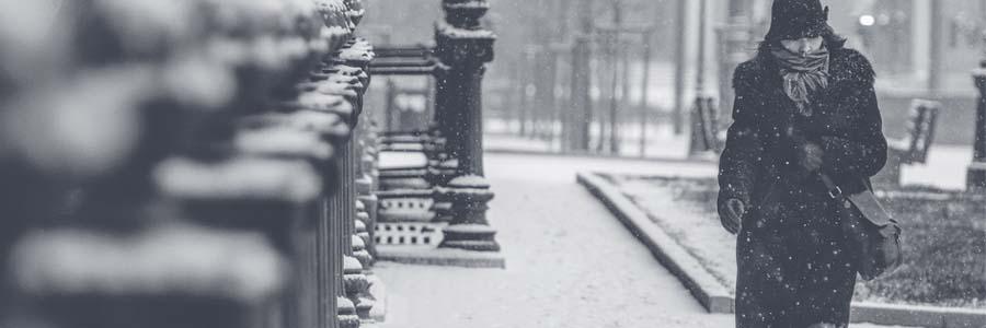 lady walking along the street in a blizzard