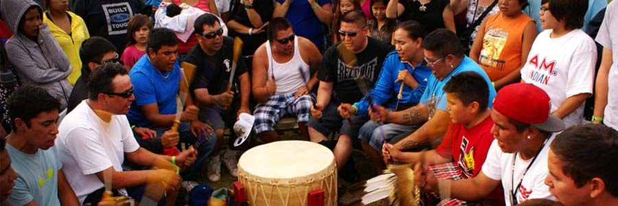 a group in a pow-wow drum circle