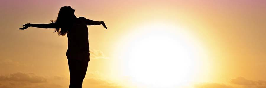 woman welcoming sunrise