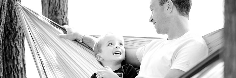 child and father on a hammock