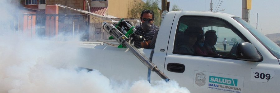 Man in a pick up truck fumigating