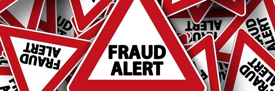 """Road sign saying """"Fraud Alert"""""""