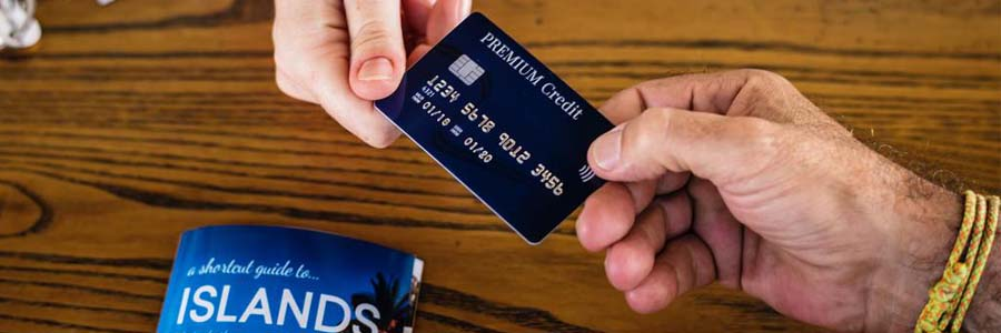 close up of hands exchanging a credit card