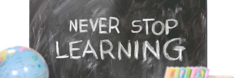 """Blackboard with text """"Never stop learning"""""""