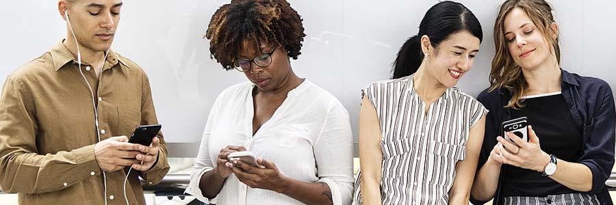 friends texting on their mobile phones